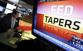 Federal Reserve Tapers Bond Buying Program